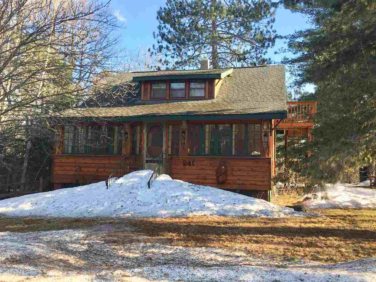 You won't feel like you're in the city when you're gathering in the tree lined, private back yard. This home has direct access to trails for hiking or biking in the summer and snowmobiling in the winter. The main level bedroom is off of the living room. Main bath off is the dining room, which is open to the kitchen. The upper level includes a second bedroom, full bath, large closet and private entry from an exterior stairway. Basement includes laundry, shower and bonus room.