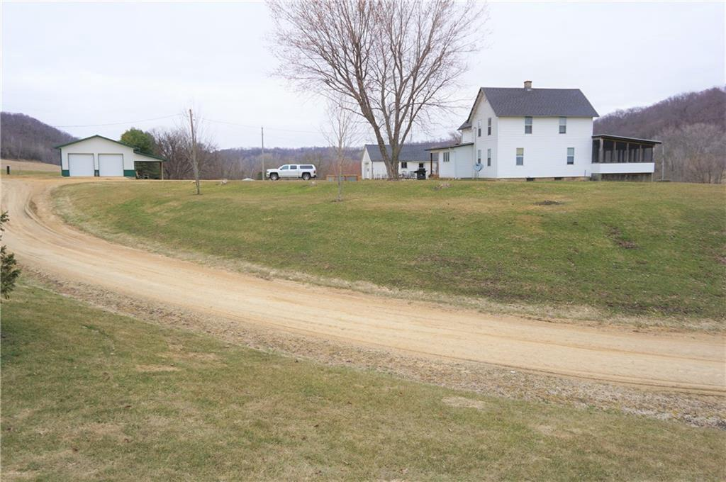 "Nice 5 acres Hobby Farm just 1 mile to town. You can see and hear Plum Creek just across the road. 1 car detached garage and 30 x 40 garage/pole shed. Shed has cement floor, 10' x 10' overhead doors, 11'7"" walls, floor drain and covered porch on side. Large home with main level bedroom, baths, laundry and 22' x 16' screen porch. Newer high efficiency furnace and water softener. Newer shingles. New well pump 2016. Central Air. 5 acres to be surveyed"