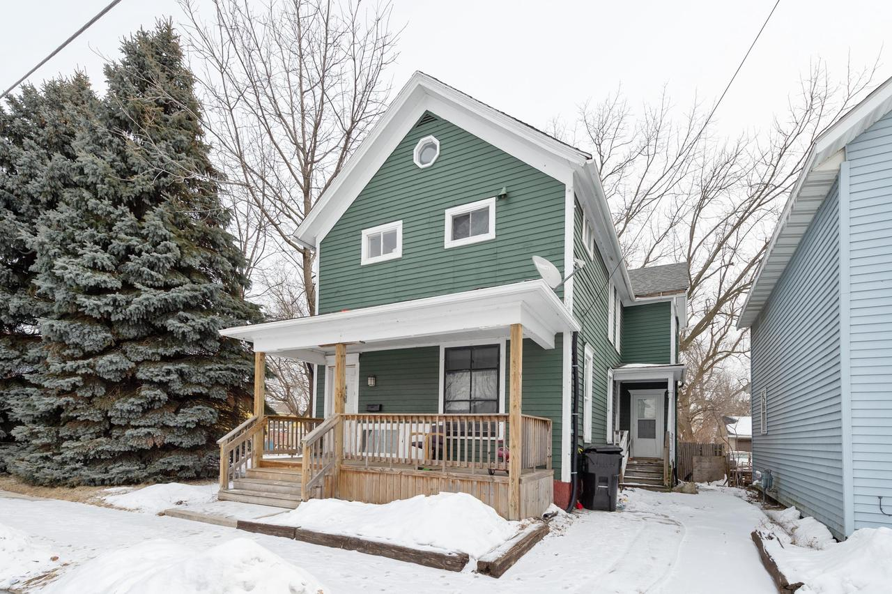 Large home on a double lot. Lot at 1327 Howe st is included tax key 08795000 .  Large garage. Long term renter will stay, is on a month to month if you wish to purchase as residence. $800 per month, always on time.