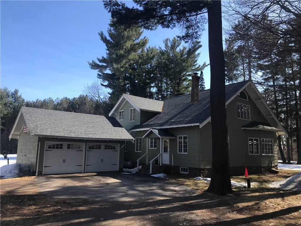 Point of Comfort - This historic, 6BR, 3BA Whitefish Lake home has been in the same family for over 50 years!  Nestled among towering oaks & pines, with 200 ft of frontage & over 3.5 acres, this charming property provides ample space and privacy.  Hardwood floors throughout, built-in storage, & numerous closets give this classic home not only charm but also functionality.  Multiple weddings, parties and priceless memories have been held here.  Sand bottom frontage, lower to moderate elevation, and a lakefront bar/deck.  An attached 2 car garage, detached 3 car garage with 16' overhang, and full basement gives plenty of storage for vehicles, toys and the like.  Truly a rare opportunity to own such a unique and special property.