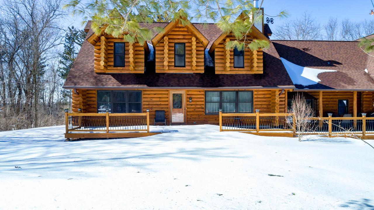 WOW is all you can say when you see this beautiful log home on nearly 7 acres with woods, pond and 4 acres of meadow behind the house at the bottom of hill, with an 8' wide path to access the meadow! Large living room, open layout with amazing fireplace. Kitchen with dinette, walk in pantry. Exposed beams and HWF throughout. Split layout bedrooms, main level master with walk in closet and soaking tub. Large deck overlooking woods. Exposed LL with plenty of storage space. Spacious rooms, upper level with loft/office area. Many Many updates, including roof, front porch, deck and mechanicals.  LOTS of privacy!