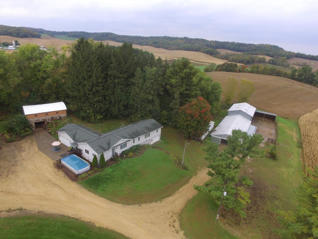 Very solid and well maintained 5 Bedroom, 3 Bath Ranch home on 60 acres with all the outbuildings for an excellent Hobby Farm set-up and perfect for horses or cattle. Enjoy over 2100 finished square feet all on main level. Finish off the walk-out lower level for even more space! Recent updates include siding, shingles, windows, flooring, 6-panel oak doors and more! Outbuildings include barn, lean-to, and pole building. The acreage is estimated and will be surveyed 21-22 acres +/- .
