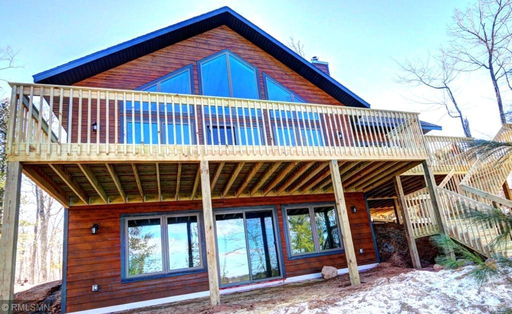 Be the first owner of this BRAND NEW chalet on Whitefish Lake! Well-built and highly insulated home with many upgrades including quartz countertops, alder cabinets, hickory flooring, wood burning fireplace and more. 3 full bedrooms plus sizable loft, fully finished walkout basement, large screen porch and deck overlooking the lake. Whitefish Lake is a very deep clear water lake and offers excellent swimming, fishing and recreational opportunities. Northwest facing for great summer sunsets! Stainless steel kitchen appliances and dock included.
