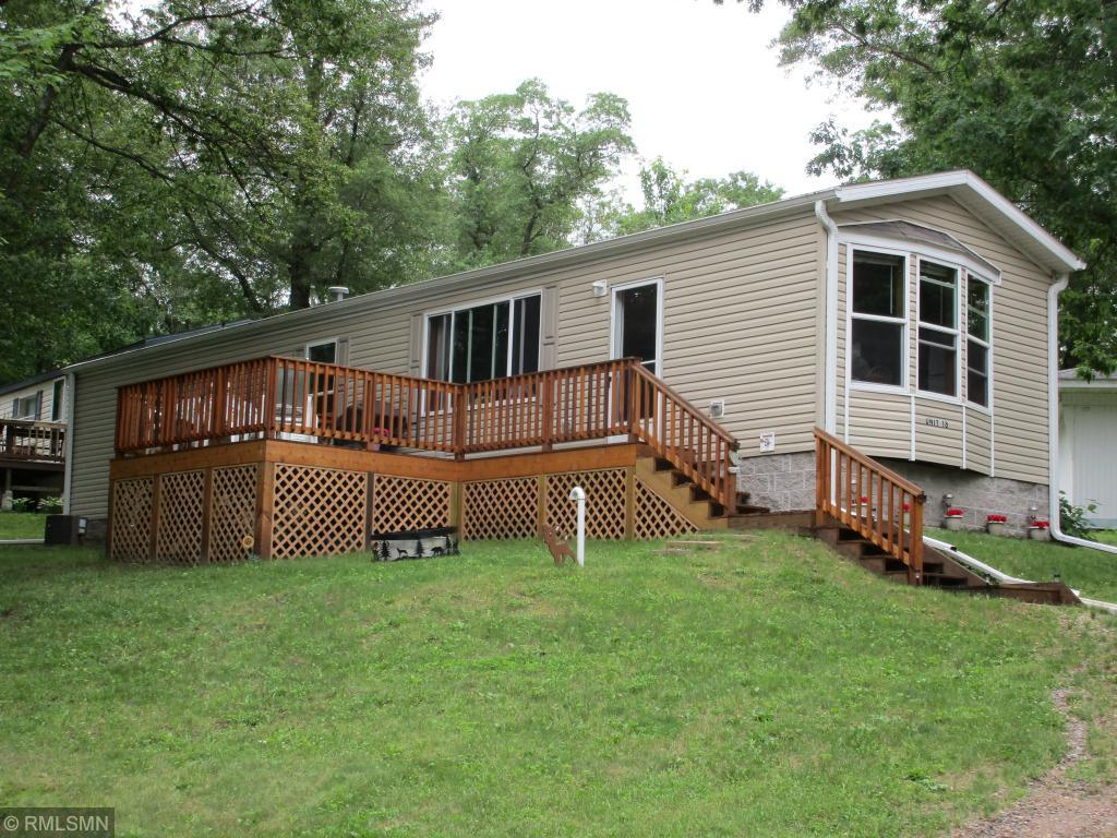 Economical escape on Pokegama Lake!!  This exceptional cabin was built in 2015 and is still like new.  Set in the Somerset Park Condominium development with over 500 feet of low elevation frontage and 4 acres of land, this cabin has access to the entire 3800 acre Chetek Chain of Lakes from a private dock slip.  Enjoy socializing in the pub located on the property or relax on the private deck and drink in the view of the lake.  If you are looking for more of a turn-key deal, some of the furnishings are negotiable. The fees are only $400 per year, which makes this a very affordable way to get on the lake.