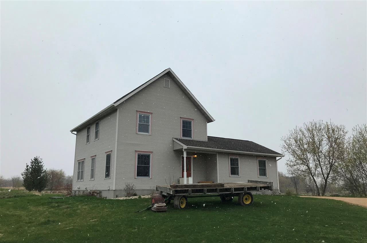 Rare Find! Minutes from Columbus you find this private 5 AC (survey to be completed) organic farm with numerous outbuildings! Built with charm of a traditional farmhouse this home features 4 BR's , 2 BA's, maple cabinetry in kitchen, cherry trim & new professional landscaping.  Insulated/heated shed (40x54) includes epoxy concrete floor, water, 200 Amp service & attached lean-to.  Greenhouse with concrete slab.  Older barn, granary & corn crib.  Additional land available.  This property has unlimited potential!