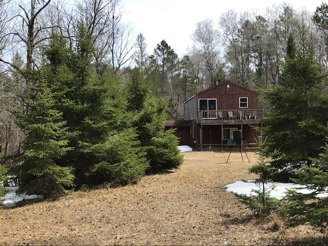 """Amazing """"Cabin in the Woods"""" set on 40 acres. Gated entrance, drilled well, septic, powered by generator. 2 wood burning stoves, 1 Heatilator LP stove. Not your typical hunting cabin, the interior is completely tongue & groove finished.  Log furniture thru out. Upper has oversized sleeping area & family rm w/woodstove. Easily sleeps 12. Covered porch & upper porch balcony. Steel deer hanging station, shed & privy. A must see property!"""