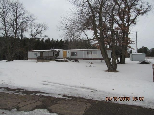 Priced 9k under assessed value! Single wide mobile home on .30 acres with 2 car detached garage on the outskirts of Bruce. Home needs work.  Survey recommended to determine to determine septic,garage and access to property.