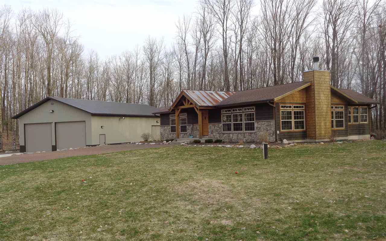 Upscale 3+ bedroom, 2 bath home or cabin with +/-19.41 acres bordering the National Forest in Perkinstown. Custom kitchen with white ash cabinets and a timber framed island with granite countertop. Living room with wood burning fireplace and vaulted ceilings. Sun/bar room with access to deck system. Large master suite with 3/4 bath. Full finished basement with family room, rec room, bedroom and bonus rooms. Main floor laundry room. Cedar siding, conventional septic, drilled well, forced air lp furnace and central air. Heated 64x40 metal shed built in 2017 with 14' ceilings and 3 overhead doors. Private location near the end of a dead end road. +/-19.41 wooded acres with excellent contour and abundant wildlife. Professionally landscaped yard. Within walking distance to Kathryn Lake. Located on the atv route and close to the snowmobile trail system. The kitchen stove, refrigerator, microwave, washer and dryer are included in the sale price. Furnishings negotiable.