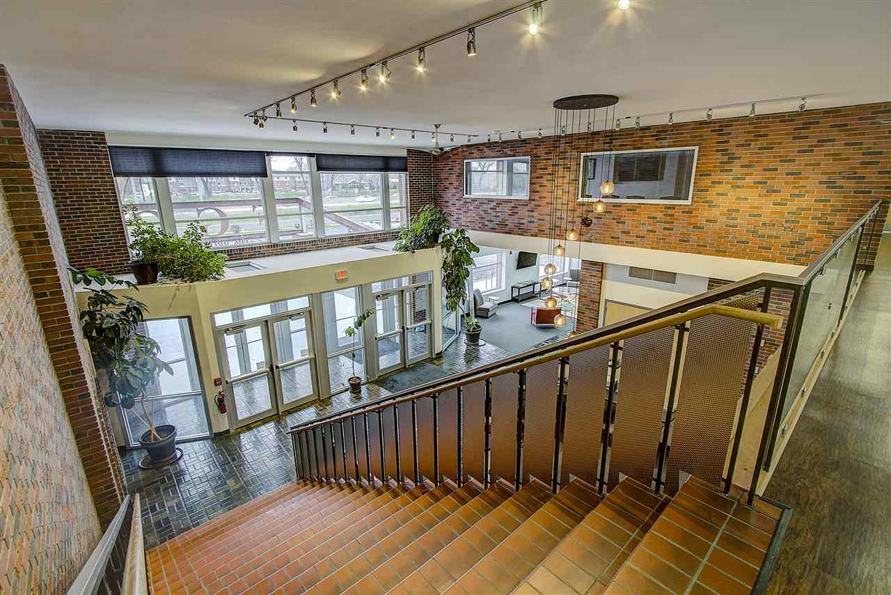 Creative brick office building ideally situated along the highway 12/18 beltline (86,000 + VPD) in close proximity to I-90/94. Building includes a dramatic reception area with a grand stairway to the open second floor, shared cafe/breakroom on first floor with outdoor courtyard. Signage available. Multiple suites available, can be combined for larger requirements. Tenants looking for 20,000 s/f + may be able to negotiate second floor space (apx. 10,000 s/f). Build out available on all suites. Build out amount dependent on strength of lease/tenant. Data Center space available, call today for more details!