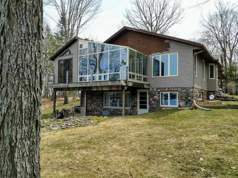 Longing for 1.3 acres, over 300' low, sandy shoreline and beautiful views?  A very well maintained home with sunroom, hot tub, family room and big, open living spaces?   How about 2 fireplaces, 2 2-car garages, and even a wooded, level, buildable lot (per surveyor)?  Yep.  It's all here.  Large cook's kitchen, tons of storage, dining room and breakfast area.  A home you can walk into and feel relaxed and easy.  Newer roof, water heater, furnace.  On quiet dead end road.  Peaceful and private.