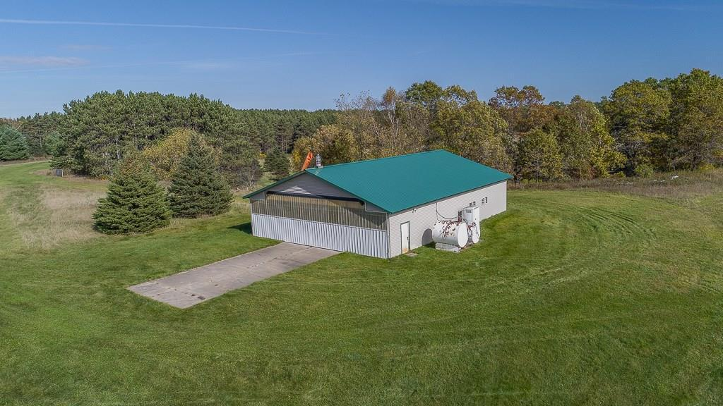 County Estate with many possibilities - hunting/camp/farm/compound. Owner has tentative plat to develop. Waterfront on the Six Lakes over 3600 of water frontage. Main house sits on 7.54 Acres (built in 1996). Rental sits on 1.54 Acres (built in 1997). Open concept well maintained home. Main floor screened porch. 2nd floor office/den/sunroom. Airplane hanger/pole building 44x60 insulated & heated + 14' door. Over 1,000 trees planted. Waterfront on both sides of the creek/river.