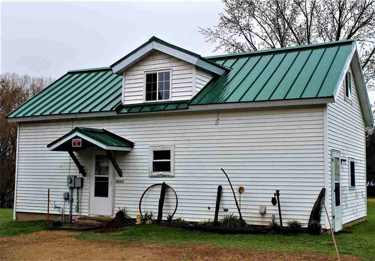 Cute 1BR/1Bath home located on 24 acres approximately(survey completed prior to closing).  The  property is currently set up for horses with a 75X30 barn with electric.  The property includes a 45X20 workshop, 21X18 corn crib and 21X9 greenhouse for all your extra storage needs.  Land extends back behind the barn for additional pasture or use as hunting land. Property can be great for a home,  hunting lodge or the hobby farmer enthusiast.  The possibilities are here for you.   Adjoining log home to the right of home is also for sale.   Refer to MLS #: 50197924.