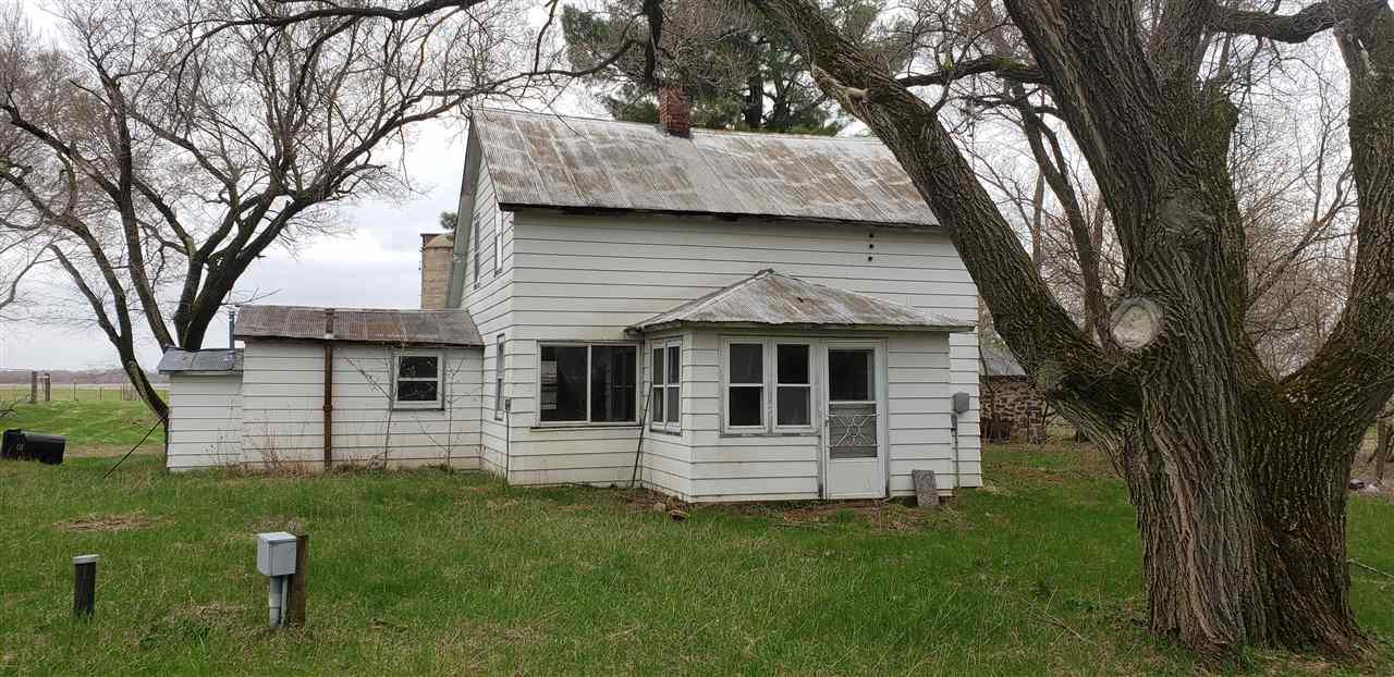 Older farm house in need of TLC. Barn is also in need of TLC but the pole building is in good shape and has 10' high sliding barn doors. The land is divided into 2 parcels but sellers want to sell it as one parcel.
