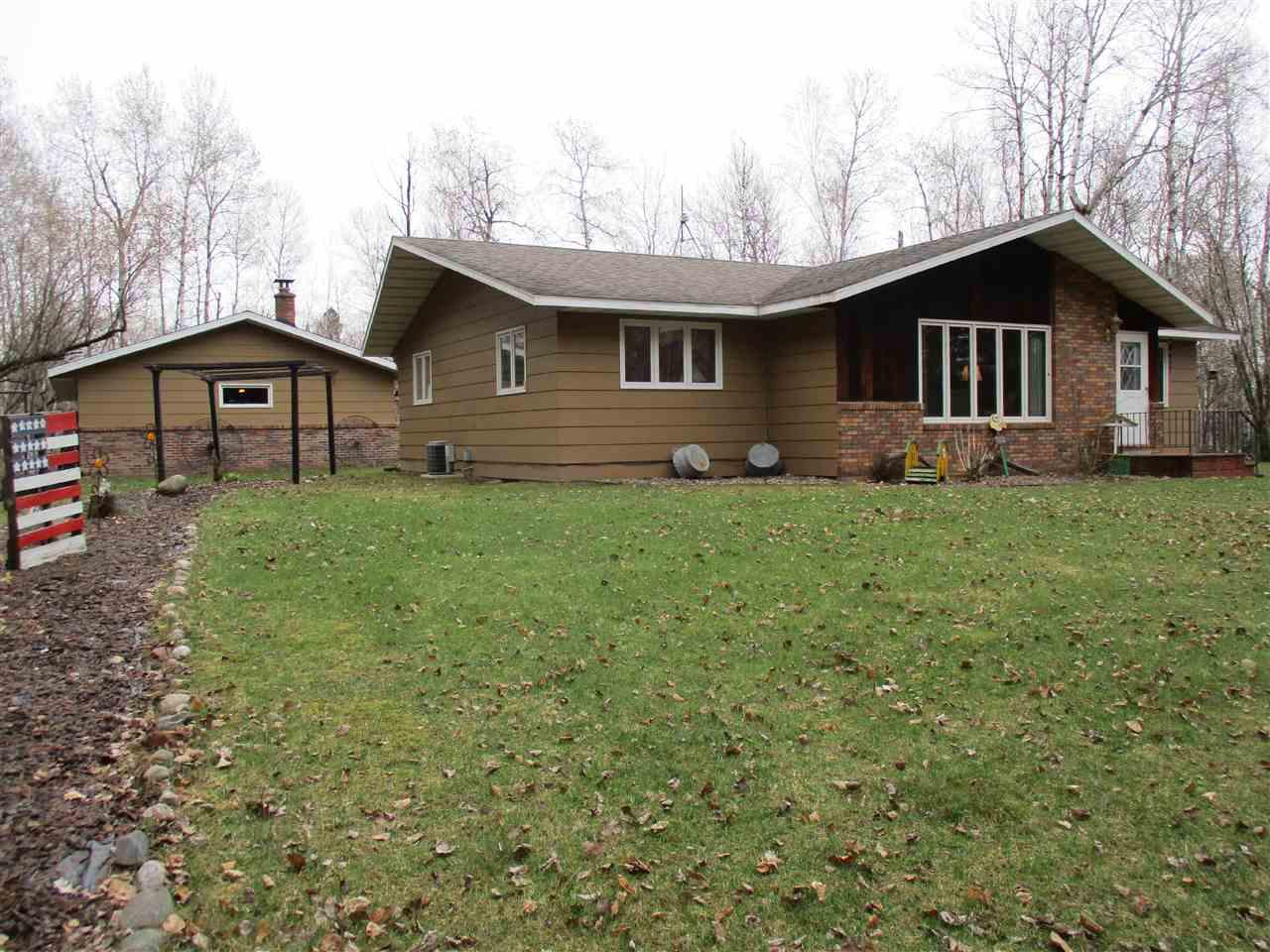 Well maintained 3+ bedroom, 2.5 bath country ranch home on +/-4.02 acres located northwest of Medford. Spacious oak kitchen with breakfast bar and walk-in pantry. Dining room. Large living room. Poured concrete basement finished with a family/rec room with bar, bonus room and bathroom. Updated roof and mound septic system. 3 car detached garage. The refrigerator, stove, dishwasher, washer, dryer, window coverings and basement bar stools are included in the sale price.