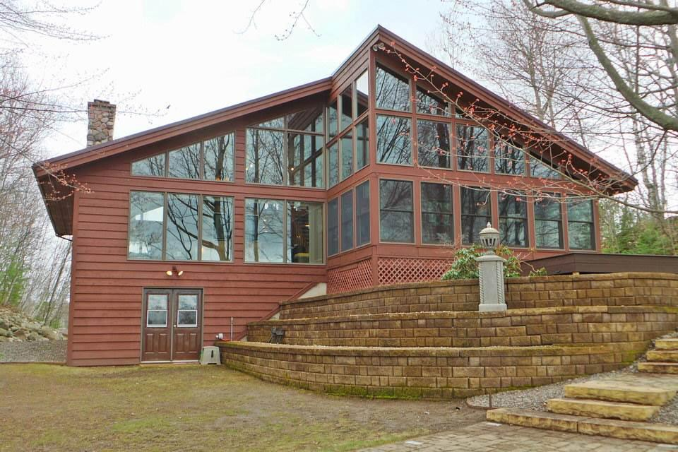 Looking for a life on the lake? Look no further, this 2 bedroom 2.5 bath home located on Sackett Lake is a perfect fit. Featuring floor to ceiling windows facing the lake, a wood burning fireplace, and select Viking appliances. You could be drinking your morning coffee in the three seasons porch tomorrow, as this house could be purchased fully furnished for $435,000.00.