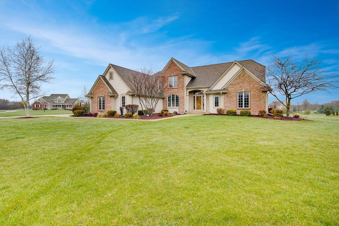 Welcome to this custom-built executive style home in Lebon Estates! Nestled on 3 acres on a quiet cul-de-sac, this Contemporary 4 BR features an updated sun-filled KIT w/birch cabinetry, Corian cntrs, new SS Appls & separate pantry. KIT opens to dining space & gathering rm surrounded by large doors & windows that lead to wrap-around deck. GR highlights vaulted ceilings & stone FP. 1st flr MBR has large dual entry WIC. MBA features separate sinks, jetted tub & shower. Main level offers laundry & powder rms, add'l room perfect for den/office & new carpet throughout!  Upstairs boasts 3 generous-sized BRs w/ample WICs. Unfinished LL has 9' ceilings & is plumbed for add'l BA. Great potential for LL to add square footage or to use for add'l storage space. Quick access to I-43.