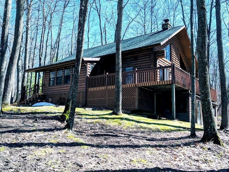 Featuring a STUNNING 3 BR., 2 Bath Northwoods Log Home that sits on 80 acres, surrounded by trees & overlooking your own private pond. Where else can you get away from it all & still be at home! Property is full of wildlife including deer, turkey, grouse, ducks, geese, & even bear. Land is loaded w/mature timber ready for harvest, ATV trails throughout, some of the finest hunting around, & it?s all out your back door. W/the 32? x 30? & 34? x 48 storage sheds, you will never run out of room!