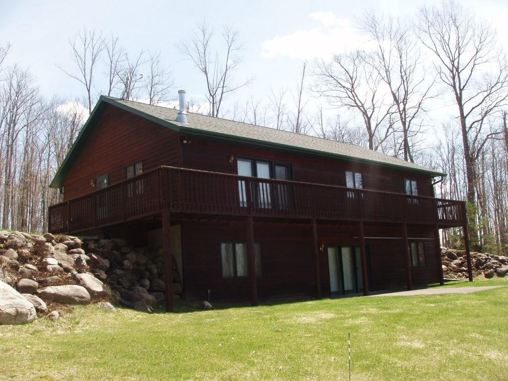 Unique parcel with 557.25 acres of wooded land with its private location off Co. Rd. E west of Park Falls has a custom built 5BR cedar sided home/hunting lodge with a full walk-out basement. Featuring a large great room on the main level with kitchen/dining area, large living room with gas fireplace, 3 roomy bedrooms and a full bath on the main level. Open stairway leads to the full walkout lower level with approx. 1,300 sq. ft. of living area which includes a family room with walkout patio door and 2BRs/bunkroom which sleep 6 in each. There is a  bath, a laundry room with stackable washer/dryer and a utility room with back-up generator. 44x60 garage/storage. The Tuscobia Trail is next to the property for great access for snowmobiling and ATV trails. Several lakes, Butternut Lake and Bass Lake, within miles of the property. Whether you are looking for the ultimate hunting experience, a family retreat or a hunting/sportsman lodge - THIS IS IT! $869,900. (16,21,28-T40N-2W)
