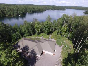 Gorgeous custom built brick ranch on pristine Carlin Lake. 3,480 square feet of the finest quality you can imagine. This is not your typical up north cabin. 439' of water frontage on Carlin Lake which is crystal clear, 153 acres with a depth of approximately 36'. It is picturesque and very private with limited access. This home boasts so many high end amenities we have attached a Special Feature sheet that can be provided by your agent or the listing agent. 3.36 acres of wooded bliss with a 2 car attached garage and an additional 2.5 car detached garage for all the toys..