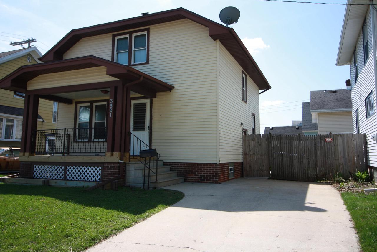 West Racine 2 bedroom with Formal Dining, Crown Moulding in Living room and Dining room. Updated bath. Newer windows. New furnace in 2018. Fenced yard