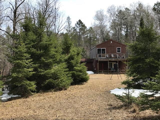 Amazing ''Cabin in the Woods'' set on 40 acres. Gated entrance, drilled well, septic, powered by generator. 2 wood stoves, 1 Heatilator LP stove. Not your typical hunting cabin, the interior is completely T&G. Log furniture thru-out. Upper has oversized sleeping area (sleeps 12 comfortably) & family room, Upper deck overlooks HUGE yard. Steel deer hanging station. Covered porch, shed & privy outside. A must see property! ATV & snowmobile from your door.