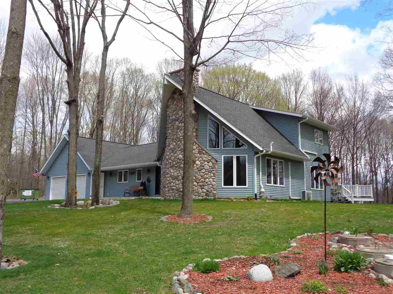 Exceptional 4 bedroom, 3.5 bathroom home only one mile from Medford on +/- 5.01 wooded acres with frontage on the Black River. Home features a secluded location on a dead end road, vaulted ceilings, wood burning fireplace, large updated kitchen with center island and hardwood flooring, walk-out basement with family room, theater room, bonus room and wet bar. Main floor master suite, main floor laundry, huge wrap around deck overlooking the Black River, heated attached garage, new 16x52 storage shed with power, RV pad and a large detached garage with heated workshop.
