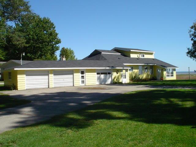 FALL IN LOVE with the Panoramic Views of Green Bay! This 4 Bed/2 Bath 1.5 story home offers more than 100' of shoreline on Gorgeous Green Bay!! Home features 1,936 sq ft of living space, parquet floors, wood fireplace, central air & a 3 car attached garage! All of this just outside of the City of Marinette!! Don't miss out on this one! Call today!*Property is being sold in ''AS IS'' condition. No warranties or guarantees written, implied or understood.