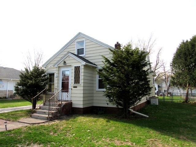 Quality 1940's home with new roofing (2017), windows and exterior doors (2017), and furnace(2019). 2 bedrooms, living room and family room on the main level. Remodeled bathroom on the main floor has a large ceramic enclosed shower with doors. Hardwood flooring in the living room, front entry with closet, and 2 main level bedrooms. Cute eat in kitchen with many cupboards and bumped out sink area. Kitchen appliances are included and less than 4 years old. Family room addition has patio doors to the back patio. Mud room/back entry has access to the large 1 car garage, family room, basement, and kitchen. Garage has a pull down attic ladder. Chain link fencing surrounds back yard.