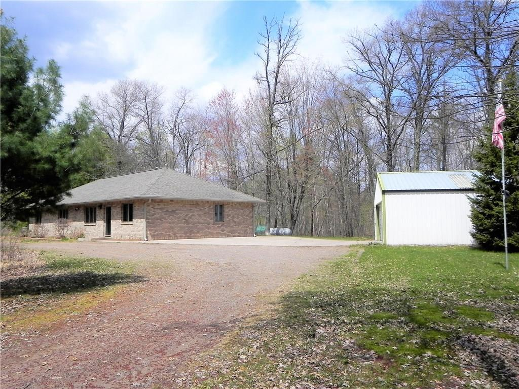Beautiful, custom-built 3BR/2BA home on 41.37 acres E of Siren. Home features large living room, kitchen island, separate dining room, carpet & tile flooring, master bedroom with walk-in closet & master bathroom with double sinks, 3-season porch & concrete patio to enjoy. In-floor heat & central AC. 2-car detached garage, storage shed plus large 24x40 pole shed with oversized door for additional parking & storage. Trails through the acreage for walking & riding ATVs. Perfect, move-in ready home!