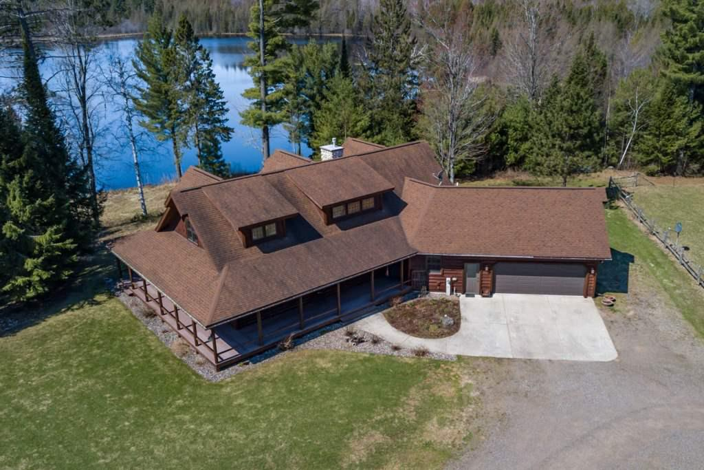 Are you tired of having to share your vacation with all the other up north tourists? Looking for a place to finally relax and be completely alone. Well STOP! Because you just found your very own slice of the American dream! This beautiful home is situated on 110 acres of private land. The house is a custom log home built by Tomahawk Log Homes. Every detail inside has been well thought out. Open concept living and kitchen area. Dining room offers plenty of space for company.,3 bedrooms are located on the main level. Master is right off the kitchen and has its own private deck and beautiful views. The loft area offers many possibilities and could even be turned into another bedroom. Basement is unfinished leaving you the potential to add even more finished square footage to this beautiful home. The home features a wraparound porch giving you the ability to enjoy the best part of this property.  Its very own 22-acre private lake! Wake up every morning to breath taking views of your own private lake. Never again do you have to worry about anyone disturbing your while you are fishing, kayaking, canoeing or any other water activity! Every person?s dream is to have the lake to themselves and that could be your reality 24/7!!! Chances like this do not come around everyday so do not let this once in a lifetime opportunity pass you by. An additional 31 acres and a guest house could be included for a grand total price of $899,900. So, let me tell you one more time. You can get an amazing house, a private lake, all the land a man could ask for, a guest house, even a barn and a pasture! Barn is equipped with power and water. Seller has previously raised llamas on the property. Everything is in excellent condition! The best summer vacation home on the market! Call today for your private showing.