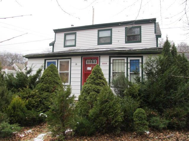 2 bedroom 1 bath plus den frame 2 story home with full basement needing major and extensive rehab and repairs. This home is not for the first time buyer, cash deals only. Property is sold as is