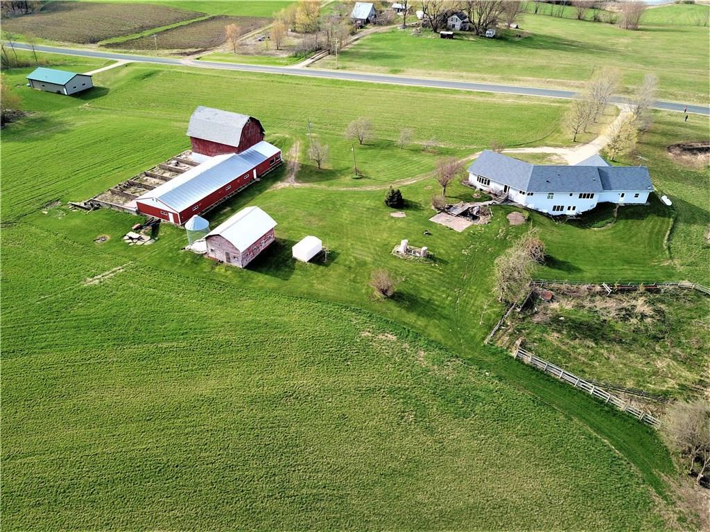 Nice hobby farm on 21.7 acres! 2464 sq. ft on main level + full walk-out Basement. Lots of potential in lower level! Wide hall leading to open kitchen, dining room & vaulted living room. Oak flooring & wide trim. 2 laundry hook ups. 32 x 42 barn plus 36 x 76 calf barn. Oversize 3 car garage has stairs to basement & rough-in for in-floor heat. 16' long master closet. Andersen windows & knockdown ceilings. Barn & hay mow in good condition. New shingles 2019. Hog House.