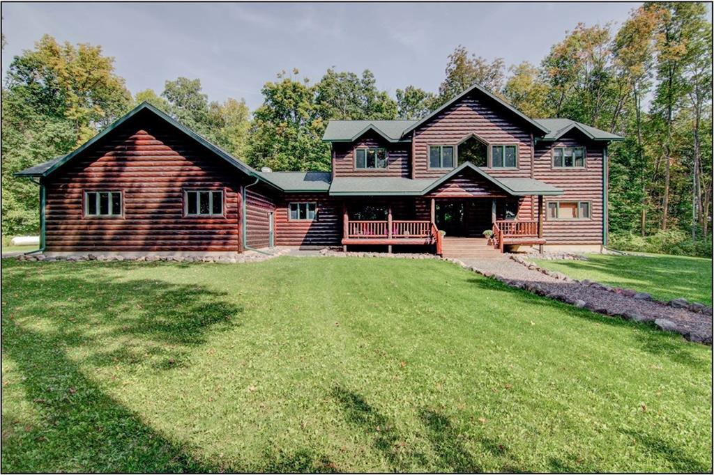 STUNNING newer 5 Bedroom / 5 Bath log sided home tucked back on a 20.5 acre parcel that includes a mixture of woods and open field / meadow. Incredible picture windows, dramatic log finishes, large gourmet kitchen, main floor laundry, incredible master suite, 4 bedrooms located on the upper level, newly finished family room in lower level, heated and insulated 36x28 garage, and in flr heat in basement. This property being sold WITH GATHERING PLACE RESORT listed at $1,650,000 MLS# 1530724 Must see!!