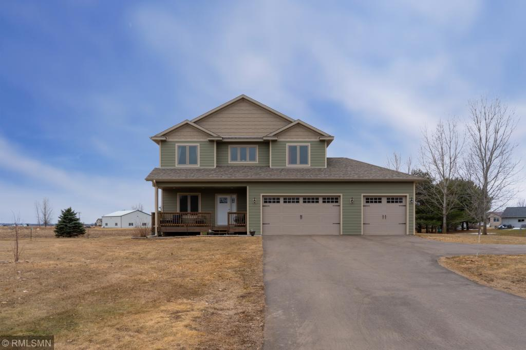 Almost new energy efficient home. 4 Bedrooms, 2 1/2 Bath, loft area, main floor office, covered front deck, 3 car garage heated & finished. Quiet dead-end cul de sac, 1.54 acres, close to schools, easy commute to the cities. Gas fireplace, open floor plan, basement unfinished with bathroom rough-in.