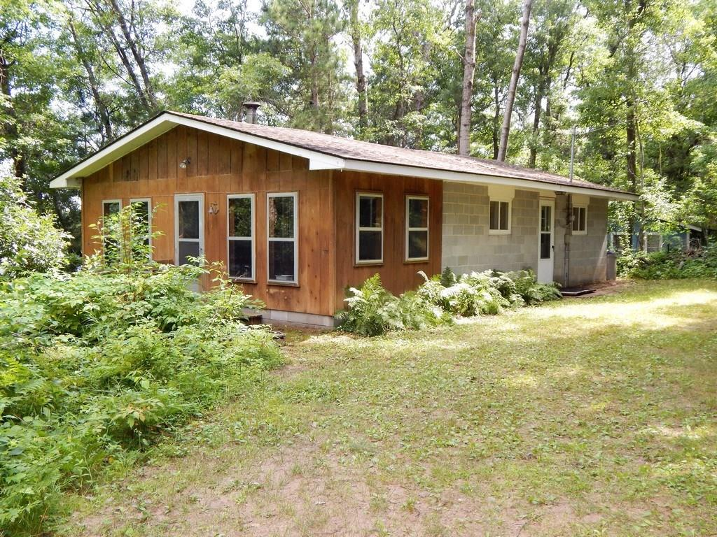 Solid roomy cabin on clean clear and private Lucerne Lake.  On 102 ft of frontage with sand bottom, this cabin has numerous possibilities!  Insulated attic and very accessible crawl space.  Open floor plan with large enclosed porch to accommodate family and friends, this fully furnished cabin is truly a value!  Minutes to Webb Lake and trails!