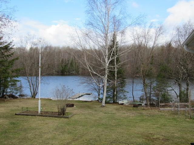 3 bedroom, 2 bath home on a picturesque, nicely wooded 5+ acre lot with 300' of level frontage on Porcupine Lake. Quality built with full basement, large lakeside sun room, central air, black top driveway, and two large detached garages. The BUNK HOUSE is a 24' x 24' garage with 9' x 9' doors below and a bunk house upstairs with a kitchen, living area, and plenty of sleeping area. The SHOP/GARAGE is 30' X 40', split into two 20' x 30' heated shop areas with in-floor heating. Also, an additional 16' x 20' insulated STORAGE SHED with a wood floor. Great vacation home, year round family home, or retirement home. Handicap access ramp and bathroom. Great location in an area of nicer homes with great neighbors. Home and buildings are on 2+- acres on lakeside of the road; 3+ acres across the road