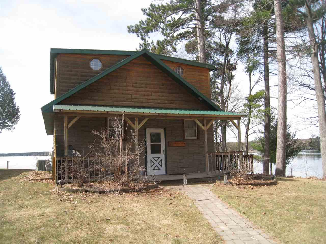 Awesome waterfront home on the beautiful 2,000 acre Lake Metonga. This walk-out home is in very good condition and offers 4 bedrooms and 3.5 baths. The open floorplan offers a full wall of windows overlooking the lake. The kitchen has maple cabinets. This flows into the dining area and the living room with an electric fireplace. 12? patio doors lead to a deck overlooking the back yard and lake. 100? dock w/ramp and jet-ski lift included. Most furnishings included.