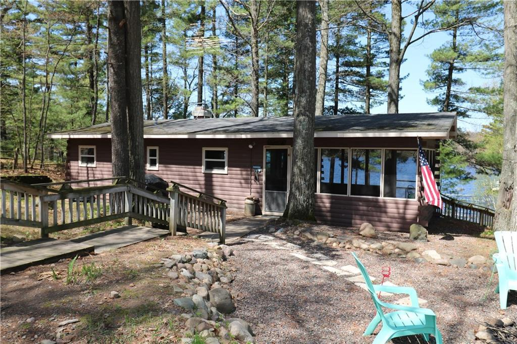 HERE IS THE LAKE CABIN YOU HAVE BEEN LOOKING FOR! This nostalgic cabin makes you feel like you're on permanent vacation. Completely set up to enjoy your weekends with an incredible screen porch and fire pit area with lake views on two sides. Charming 2 bedroom complete with woodburning fireplace, indoor full bath and cute outdoor privy for overflow guests. Sandy shoreline leads to pristine Horseshoe Lake under 1.5 hours from the Twin Cities. Start enjoying the weekends how they were meant to be.