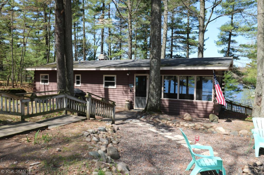 HERE IS THE LAKE CABIN YOU HAVE BEEN LOOKING FOR! This nostalgic cabin makes you feel like you're on permanent vacation. Completely set up to enjoy your weekends with an incredible screen porch and fire pit area with lake views on two sides. Charming 2 bedroom cabin complete with woodburning fireplace, indoor full bath and cute outdoor privy for overflow guests. Sandy shoreline leads to pristine Horseshoe Lake under 1 1/2 hours from the Twin Cities. Start enjoying the weekends the way they were meant to be.