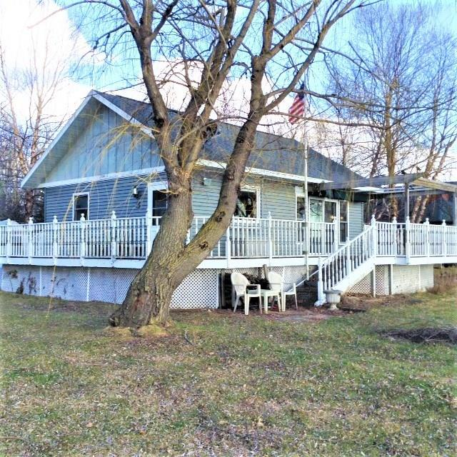 Opportunity awaits on sought-after Shell Lake! Well-maintained cabin with charm. Ongoing updates. Level sandy frontage, magnificent lake views, and amazing sunsets. Matching 30x30 garage w/ heated shop. Family owned for over 40 years. Includes boat lift, Crestliner fishing boat, motor and trailer, and row boat.