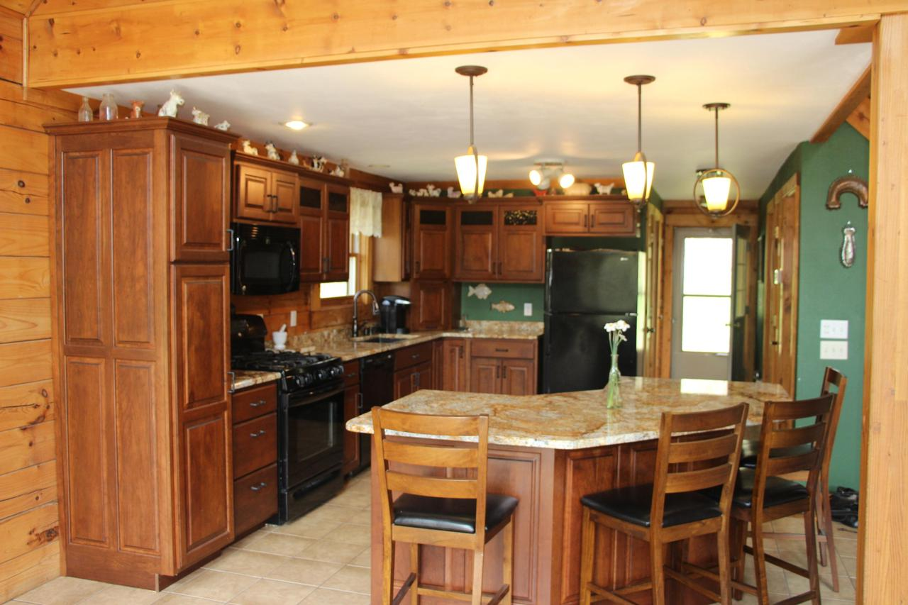 In a peaceful & private valley setting this log home is the escape retreat you have been looking for!! This 3 bed, 3 bath home features a updated kitchen, oversized living area w/ 15' vaulted ceilings & soaring stacked stone wood burning fireplace! Oversized closets, workshop/Rec. Room provide all the storage you could ever need! There is 2 decks overlooking your own private valley The tuck under 1 car garage, central air & infloor heat are great attributes! The 35x54 pole barn accompanies this great country retreat featuring 3 garage stalls, oversized sliding door , 2 horse stalls and tack room. If all that isn't enough this great home & pole barn sits on a picturesque 80+/- Acres!