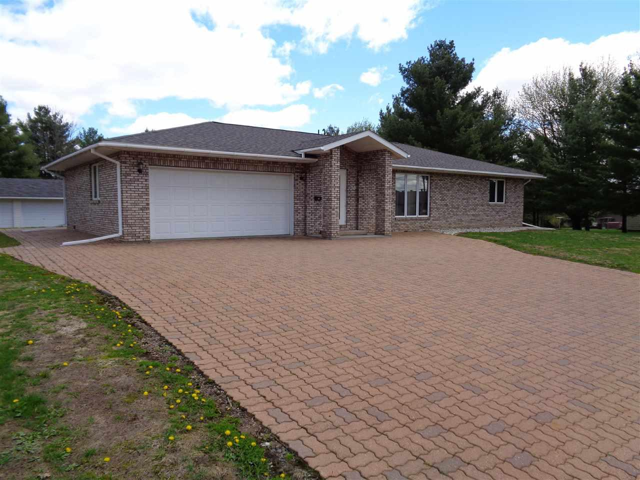 Like new all brick City of Medford home with 2 bedrooms and 3 bathrooms. Kitchen has tile floor and oak cabinets. Spacious family room with exercise room, craft room and office on the lower level. Terra lock concrete block driveway and patio. Heated attached 2 car garage and 3 car detached garage/shop. Stove, refrigerator, dishwasher, microwave, washer, dryer, and all window coverings are included in the sale price.