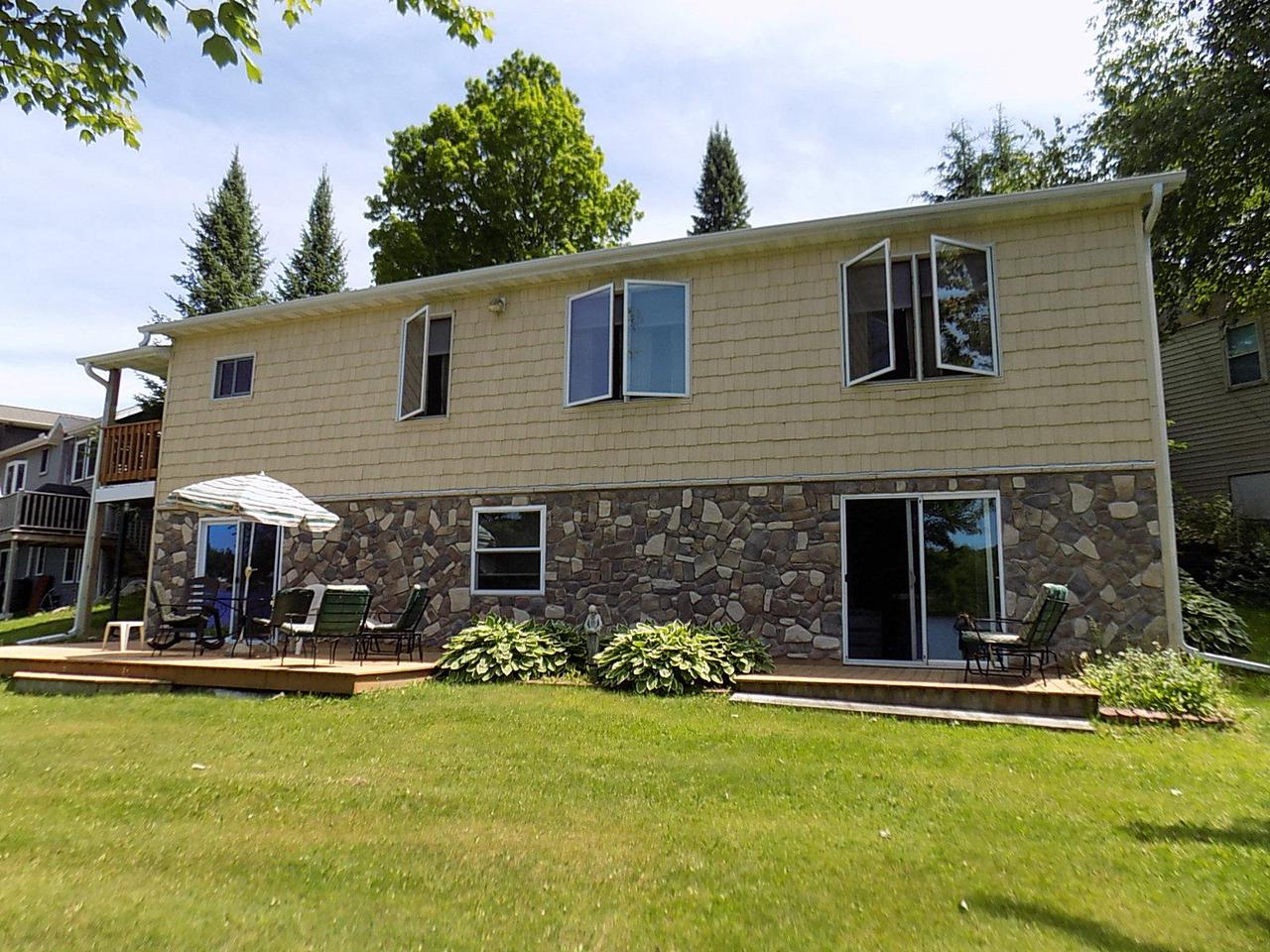 Enjoy this 4 bed 1 bath home on full rec Trump Lake with Beautiful 98 ft. of sand frontage. Home has free standing stove, kitchen pantry, plenty of room and closet space. 24x24 detached garage,8x20 deck and 12x50 Lower deck to watch the sunsets, with Seating area by the Lake. This is a Beautiful Home with Beautiful Frontage, so Call Today for Your Private Showing!