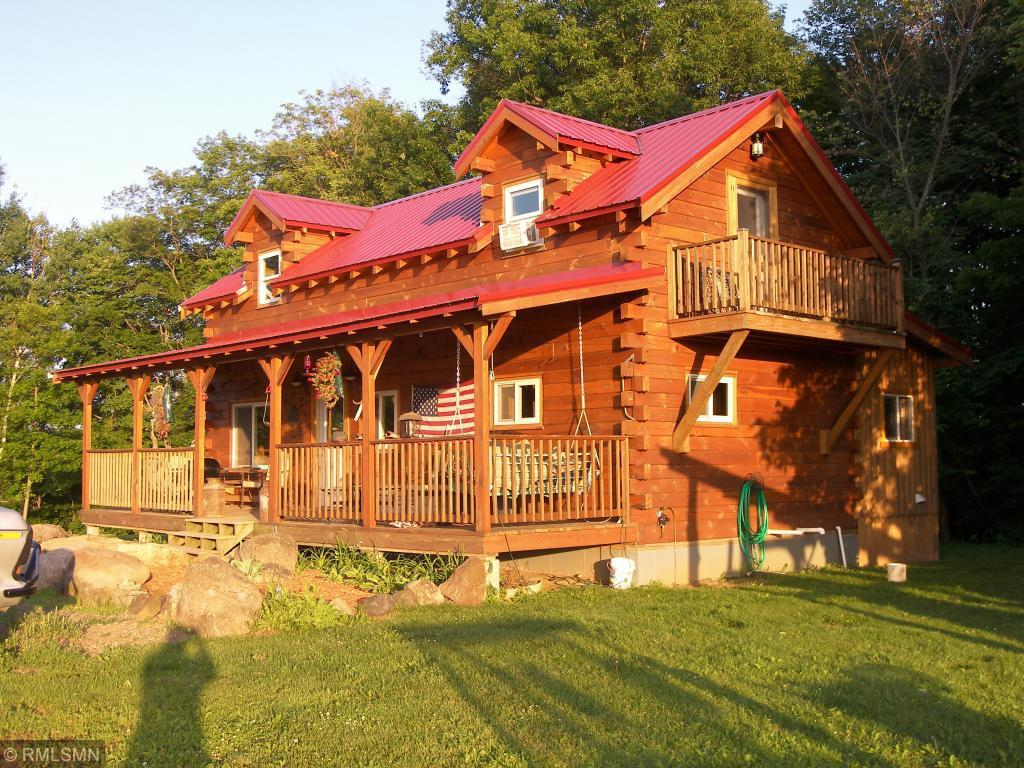 HOBBY FARM! This property features a 3 BR, 2.5 BA, Amish built log home on a full poured basement. Finished 4-season porch on the south side & open front porch to the north. Nestled into the wood line of a 40-acre parcel; 8x10 firewood storage shelter; 8x10 chicken coop; Fenced garden; 20x30 storage shed w/water hydrant; Horse shelter w/fenced pasture area; 30x60 pole shed w/cement floor, half is fully insulated & heated; 2/3 wooded w/ meandering recreational trails.