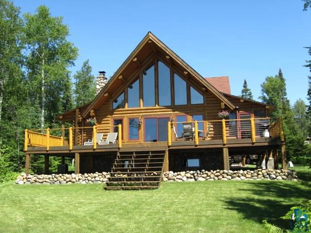 "Truly a ""Must See"" to appreciate this stunning full log home and the spectacular Lake Superior views of Roman's & Bark Point, BIG water, North Shore horizon onto Silver Bay, Cornucopia's harbor/Siskiwit Bay and beyond. Facing due West you will be amazed with your sunsets and the array of colors that light up the sky after sunset! Located only 2 miles from Corny's sand beaches (Meyers and town beach), 2 marina's, retail and pure water public well.  Open floor plan, real stone wood burning fireplace for wonderful ambiance and intense heat. Enjoy gazing at the Lake and boats from your entire main floor and huge wooden deck (28x14) Balconies off of master bedroom and loft office space. Cozy 3 season porch with functioning hot tub included. Boardwalk and stairs provide access to the lake or hang out just above the waves on a flat brownstone outcropping...what a special place to be indeed!"