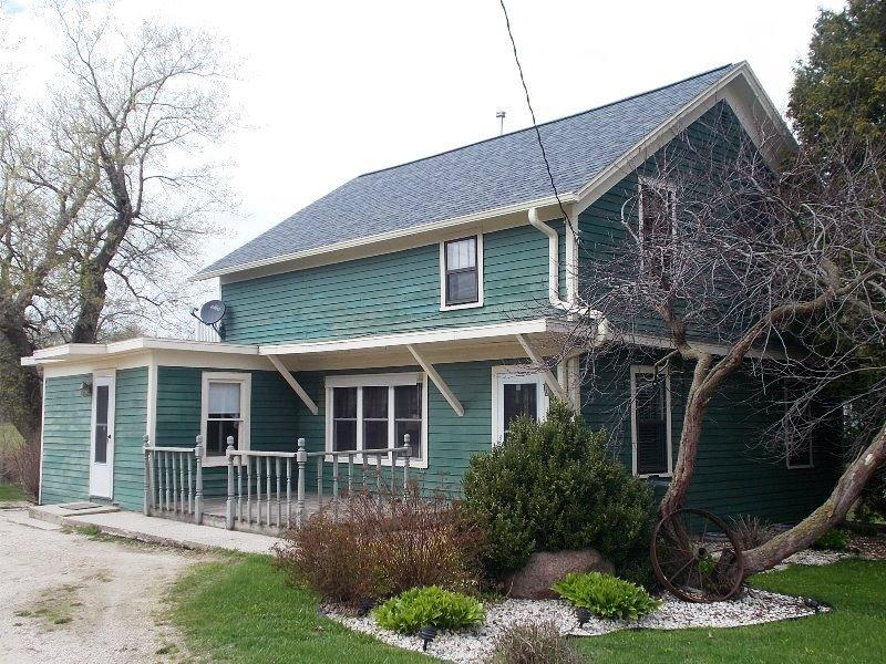 A ''TRUE 5 ACRE HOBBY FARM SETTING with pastures & rolling hills, and YES horses & animals allowed. Many updates on this 4-5 bedroom country home (look under docs) that will win your heart over! Hardwood floors, 1st floor laundry, dual entrance to upstairs, so quaint & charming throughout! Outdoors there's a delightful heated cabin/hobby room/store along with 2 car detached garage & barn. Home is accessed by a circular driveway as well.Must see to appreciate this Special Property!!