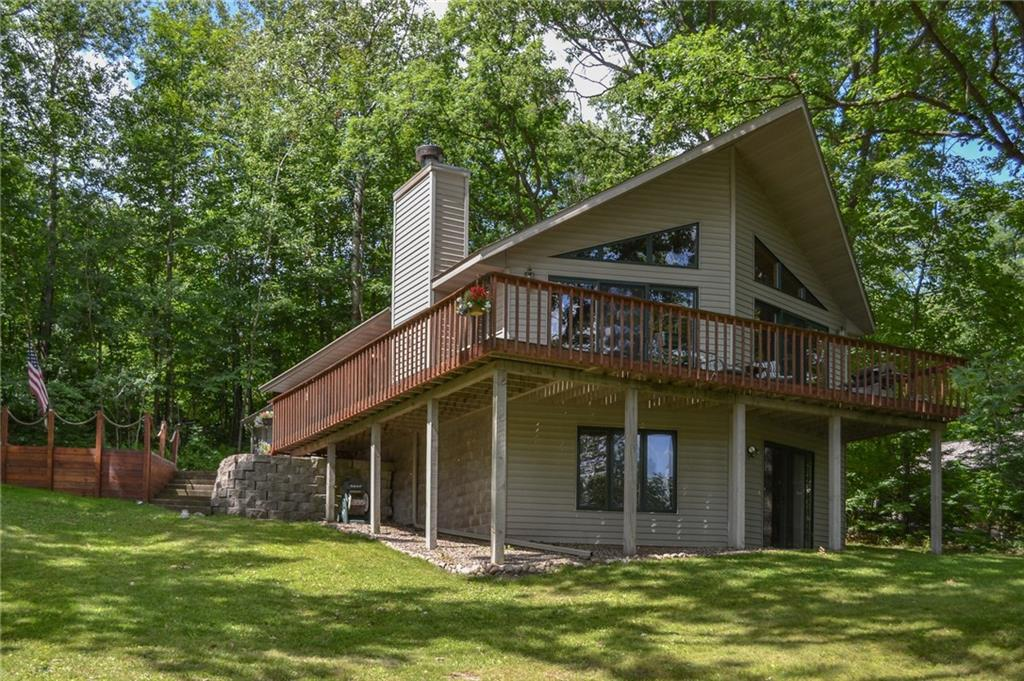 Welcome to the peaceful side of Lake Wapogasset! Quiet, nature preserve like setting with views of undeveloped shoreline and wildlife abound.  Enjoy Polk County?s 3rd largest lake with fantastic fishing. 2BR + den, 2 BA home with main level open concept, beautiful fireplace, vaulted ceilings and full finished basement with wet bar.  No need to take the dock and boatlift (included) out in the winter here for ease of work!  Move in ready, newer furnace, water heater, roof and paved driveway.