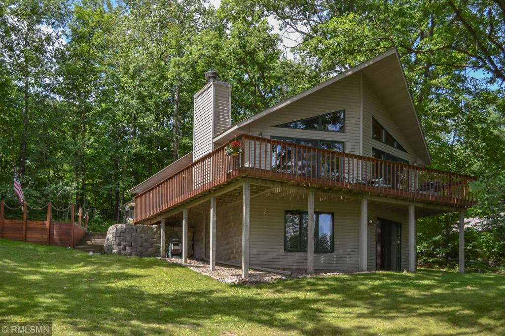 Welcome to the peaceful side of Lake Wapogasset! Come see this quiet, nature preserve like setting with views of undeveloped shoreline and wildlife abound.  Enjoy Polk County?s 3rd largest lake with fantastic fishing: musky, walleye, northern, bass and panfish.  This 2BR (both with walk-in closets) + den, 2 BA walkout home offers a main level open concept with beautiful river rock fireplace, vaulted knotty pine ceilings and a full finished basement complete with wet bar.  At this location, no need to take the dock and boatlift (included in sale) out in the winter for ease of work and peace of mind!  Move in ready, newer furnace, water heater, roof and paved driveway.