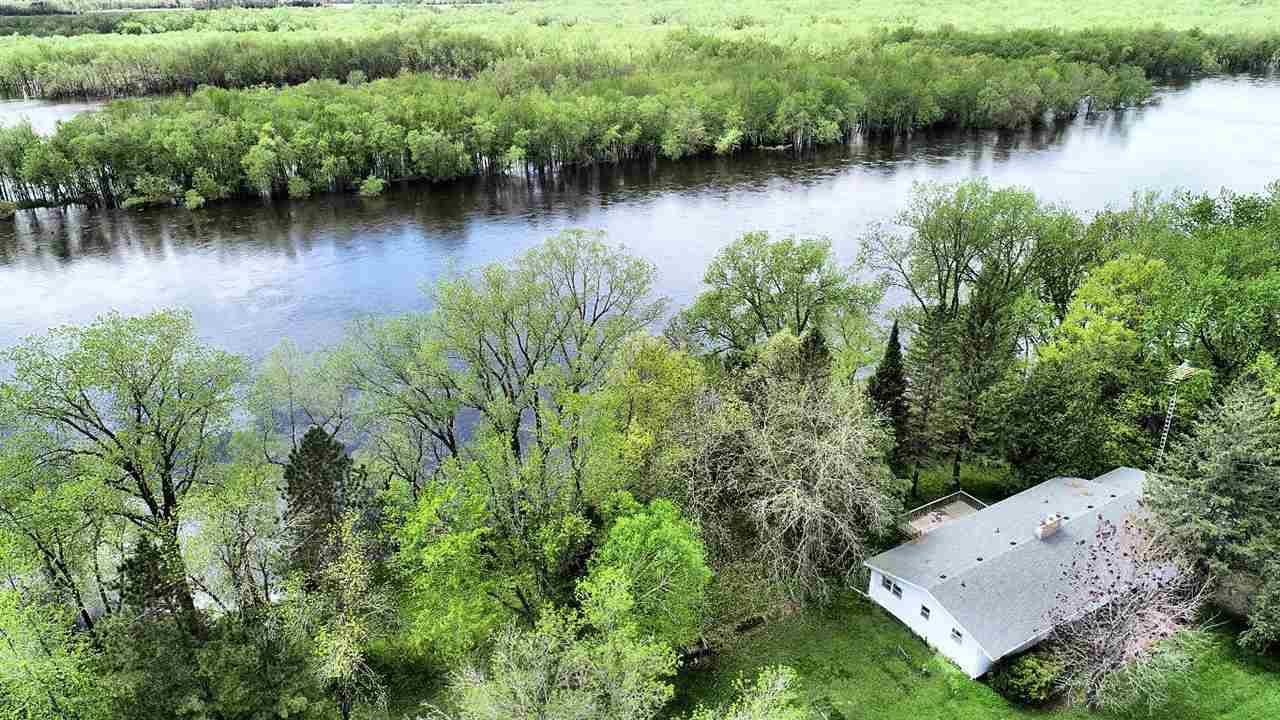 Over 800 feet of water frontage on the beautiful upper Dells Wisconsin River. Grab your boat and meander along the river while enjoying the views. This 60 acre parcel is only minutes from all the Dells attractions yet tucked away and private. Approx 55 acres are leased to a local farmer for crops for extra income. Great soil for a lavender farm if you want to start a business. Horses allowed. Primary home has 3 bedrooms and full finished basement. Second home has 2 one bedroom apartments for rental income potential. 2 septics, 2 wells, 2 LP (owned) tanks, large 25x40 shed for all your toys and equipment.