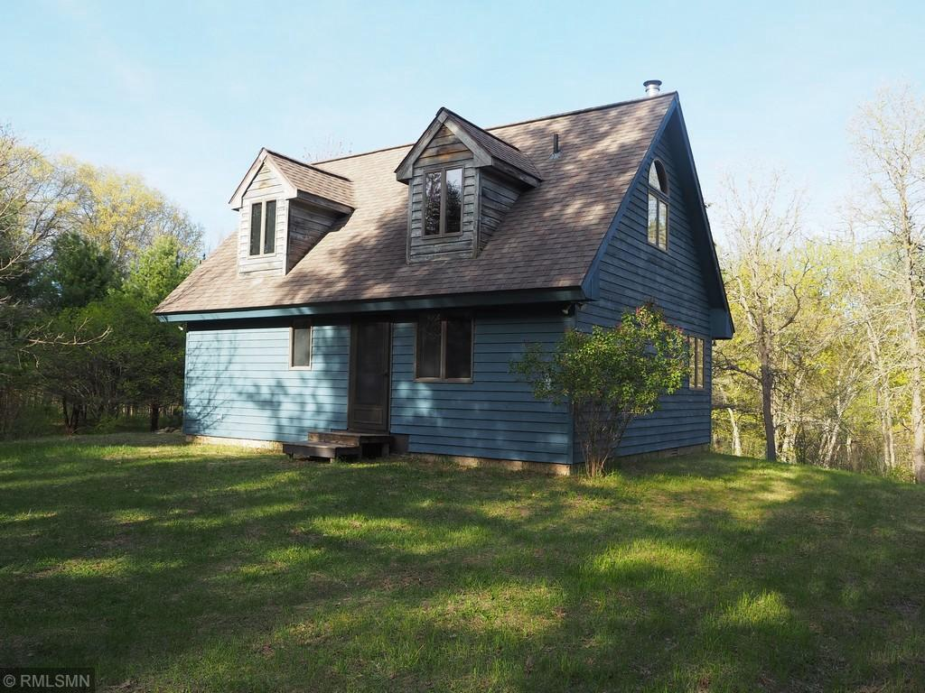 Almost 40 acres with cabin on the So. Fork of the Clam River.  Wildlife paradise.  Very private. Deer, Turkeys, and more. Well built chalet cabin overlooking the river. Ready for  interior finishing and for adding electric power, well and septic.  Nicely wooded and open areas.  Towering pines, large oaks and ideal habitat for wildlife.